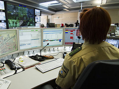 Image of a police officer sitting in a control room