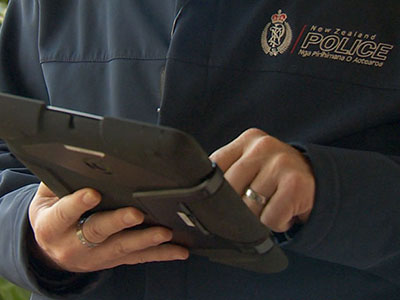 New Zealand police officer crime views data on mobile tablet