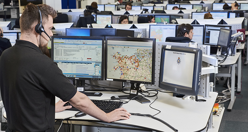 a male dispatcher using three monitors to complete his job