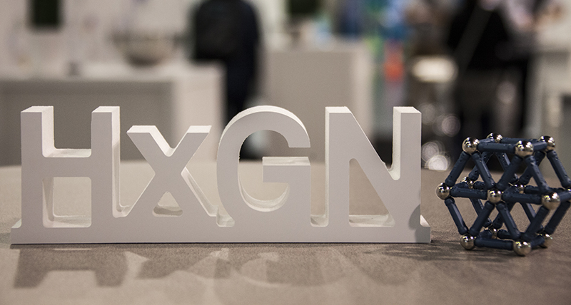 the letters HxGN sitting on a table