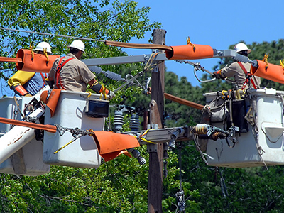 Maintenance workers repair damaged power line