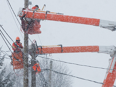 Electric workers work to restore power