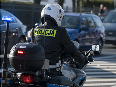 Police officer patrols on a motor bike