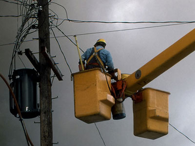 Photo of electrician maintenance worker repairing power lines