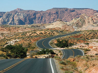 Winding highway in Nevada arid landscape