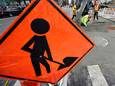Road workers working on public sewer system